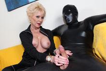 Mature slut Nikki milking a huge cock