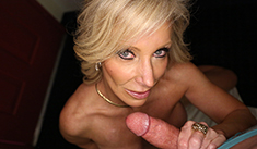 Hot MILF Tiffany slides hard cock between her massive tits and spurt all over them