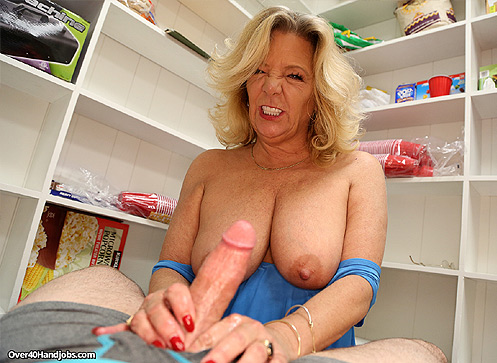 Busty milf jerking off monster sized cock